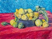 cesto di limoni su tovaglia rossa